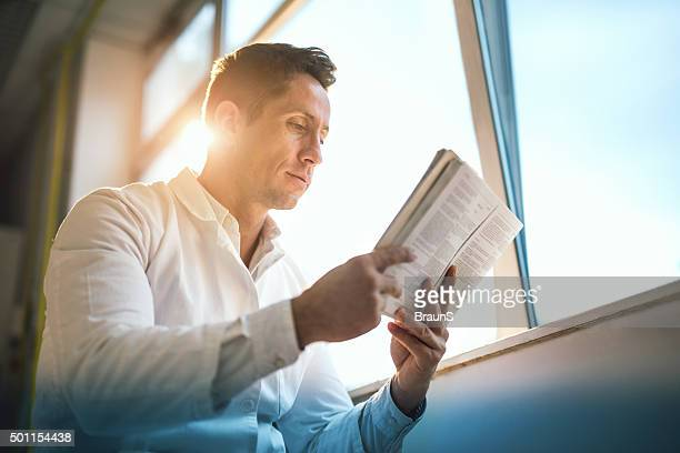below view of a male doctor reading medical data. - publication stock pictures, royalty-free photos & images
