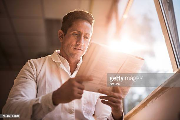 Below view of a male doctor reading medical data.