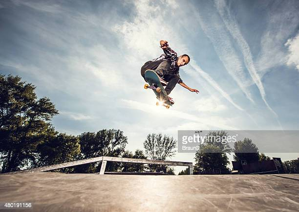 Below view of a street skateboarder in Ollie position.