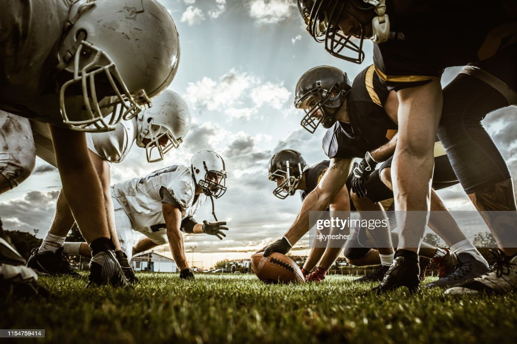 Below view of American football players on a beginning of the match. : Stock Photo