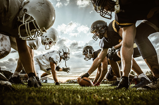 Below view of American football players on a beginning of the match. 1154759414