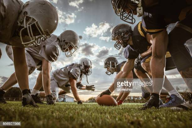 below view of american football players on a beginning of the match. - sport di squadra foto e immagini stock