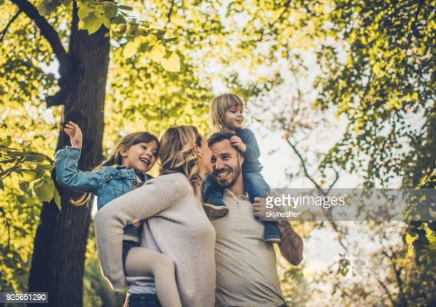 below view of carefree family having fun in spring day. - happiness stock pictures, royalty-free photos & images