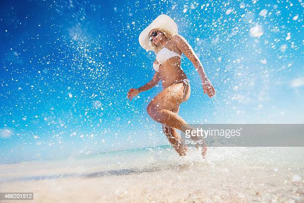 Below view of carefree woman having fun in the sea.