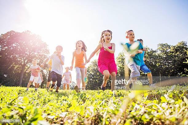 Below view of cheerful children having fun outdoors.