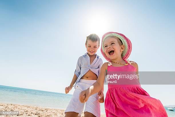 Below view of cheerful kids having fun at the beach.