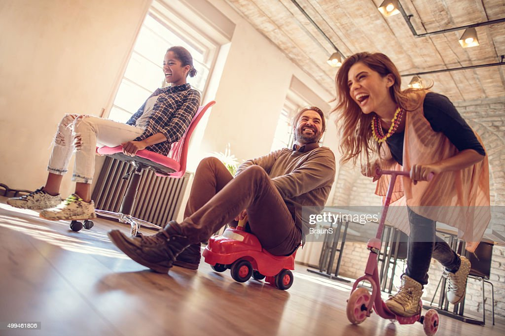 Below view of childish people competing in the office. : Stock Photo