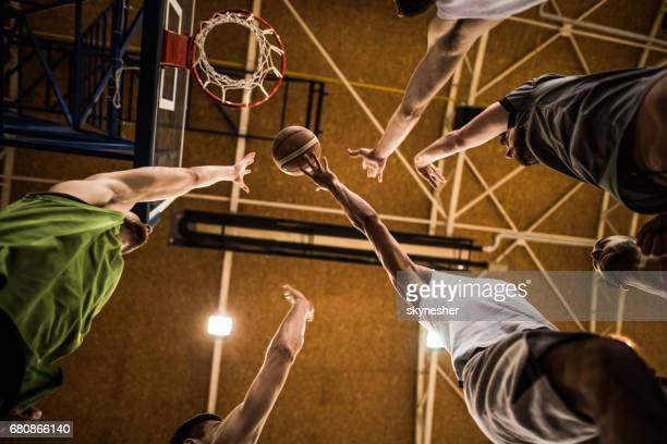 Below view of group of basketball players during a match.