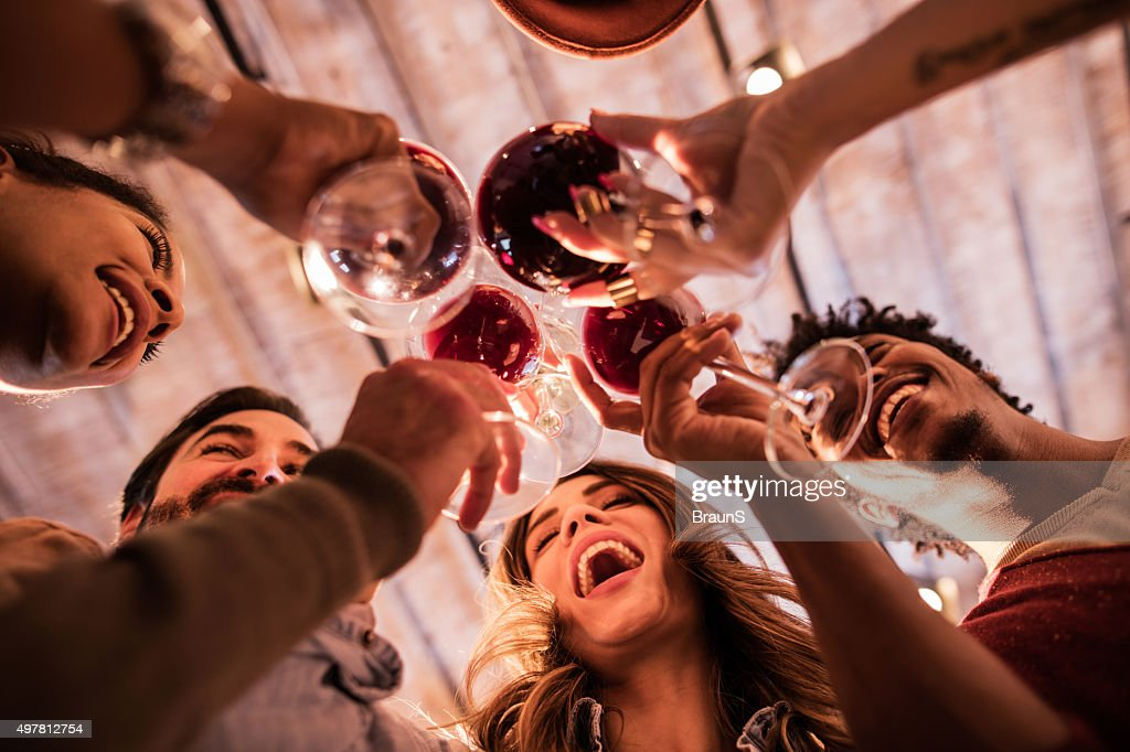 Below view of group of friends toasting with wine. : Stock Photo