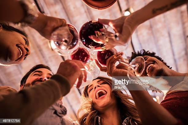 below view of group of friends toasting with wine. - party social event stock pictures, royalty-free photos & images