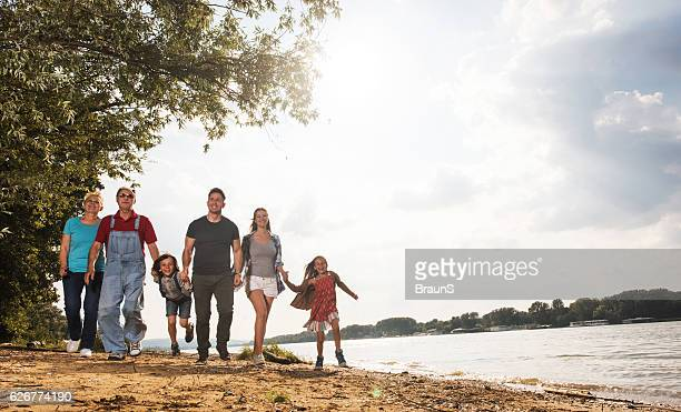 Below view of happy extended family having fun in nature.