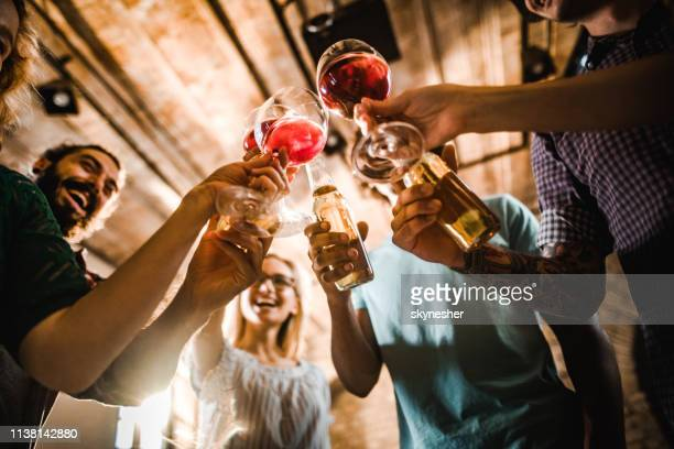 below view of happy friends toasting with alcohol on a party. - honour stock pictures, royalty-free photos & images