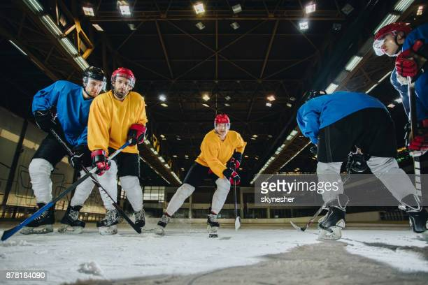 below view of ice hockey players tackling during a match. - ice hockey player stock pictures, royalty-free photos & images