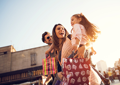 Below view of young cheerful family in shopping. 489803256
