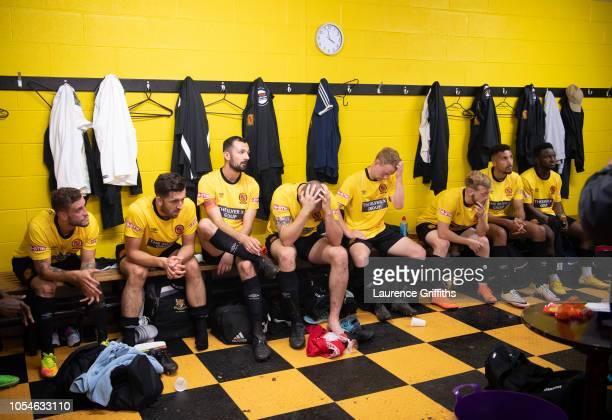 Belper Town players reflect on the first half as they listen to a team talk from manager Gran Black in the half time break during the FA Preliminary...