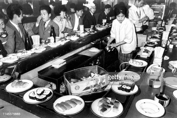 Belt conveyer sushi restaurant Genroku Zushi on April 25, 1962 in Osaka, Japan.