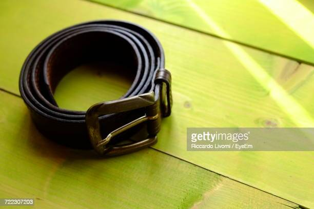 Belt On Green Wooden Table