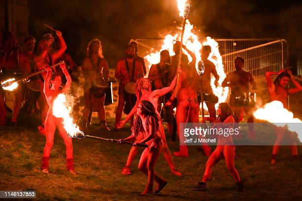Beltane Fire Society performers celebrate the coming of summer by participating in the Beltane Fire Festival on Calton Hill April 30, 2019 in...
