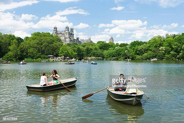 Belvedere Castle and boaters on Turtle Pond in Central Park lake, New York City, NY, USA