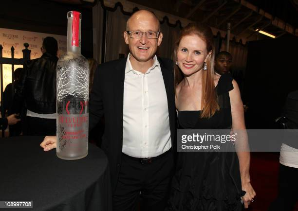 Belvedere President Charles Gibb and guest sign the RED bottle at the RED launches with Usher on February 10 2011 in Hollywood California