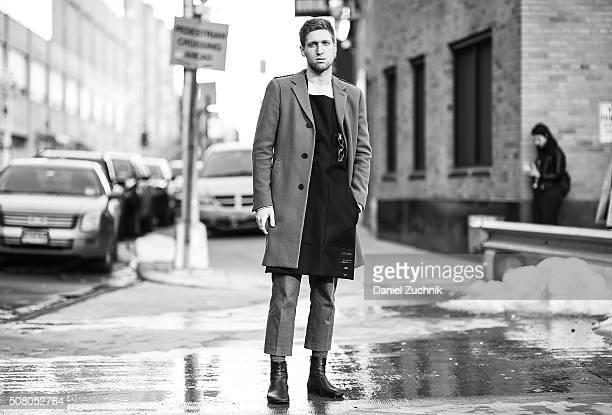 Ben Achilles is seen outside of the Robert Geller show wearing a Lanvin coat Raf Simons apron APC sweater Marni pants and Margiela shoes during New...