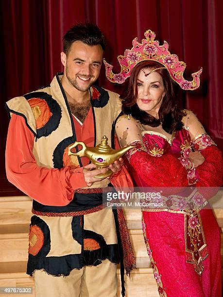 Ben Adams and Priscilla Presley pose during a photocall for 'Aladdin' at Milton Keynes Theatre on November 18 2015 in Milton Keynes England