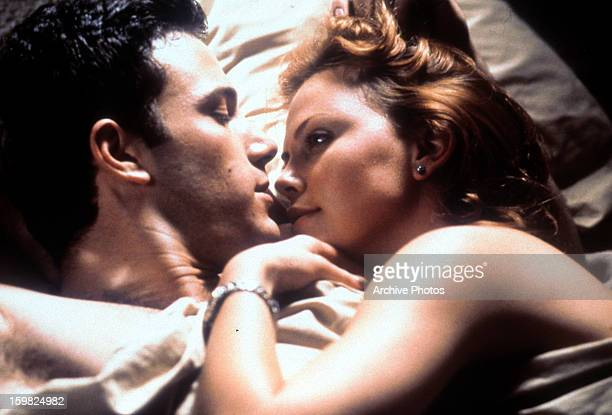 Ben Affleck and Charlize Theron in bed together in a scene from the film 'Reindeer Games' 2000