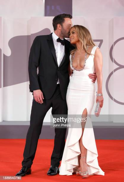 """Ben Affleck and Jennifer Lopez attend the red carpet of 20th Century Studios' movie """"The Last Duel"""" during the 78th Venice International Film..."""