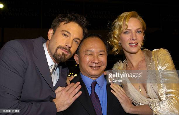 Ben Affleck John Woo Director and Uma Thurman during 'Paycheck' World Premiere Red Carpet at Graumann's Chinese Theater in Hollywood California...