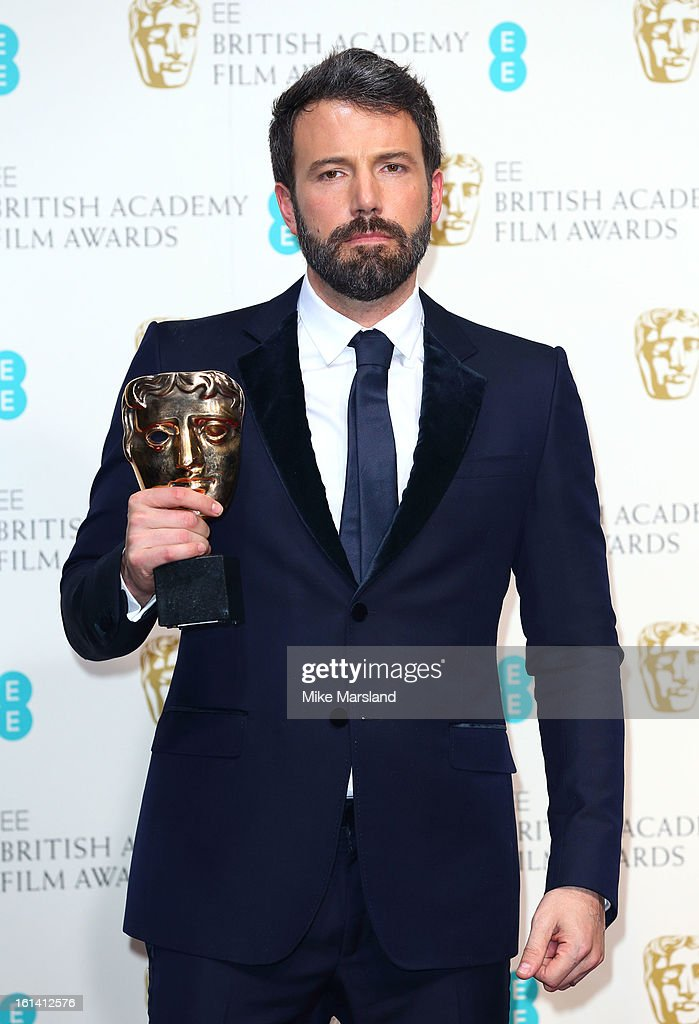 Ben Affleck poses in the Press Room at the EE British Academy Film Awards at The Royal Opera House on February 10, 2013 in London, England.