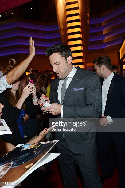 Ben Affleck signs autographs for fans at the world premiere of Runner Runner at Planet Hollywood Resort Casino on September 18 2013 in Las Vegas...