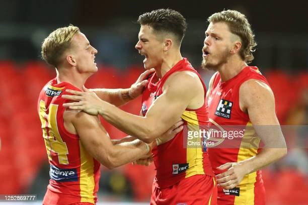 Ben Aimsworth of the Suns celebrates a goal during the round 4 AFL match between the Gold Coast Suns and Fremantle Dockers at Metricon Stadium on...