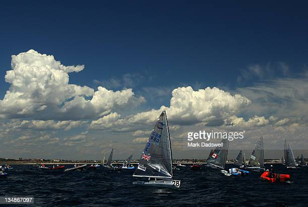 Ben Ainslie of Great Britain awaits wind conditions to improve for racing in the Finn class during day three of the 2011 ISAF Sailing World...
