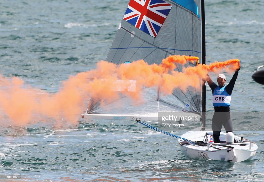 Ben Ainslie of Great Britain celebrates overall victory after competing in the Men's Finn Sailing Medal Race on Day 9 of the London 2012 Olympic Games at the Weymouth & Portland Venue at Weymouth Harbour on August 5, 2012 in Weymouth, England.