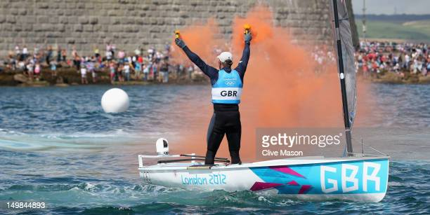 Ben Ainslie of Great Britain celebrates overall victory after competing in the Men's Finn Sailing Medal Race on Day 9 of the London 2012 Olympic...