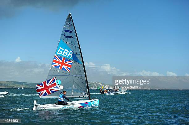 Ben Ainslie of Great Britain celebrates winning gold in the Finn Class Medal race at Weymouth Harbour on August 5 2012 in Weymouth England