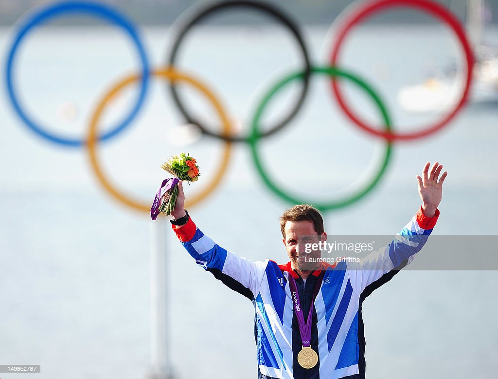 Ben Ainslie of Great Britain celebrates winning gold in the Finn Class Medal race at Weymouth Harbour on August 5, 2012 in Weymouth, England.