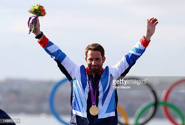 Ben Ainslie of Great Britain celebrates with the gold medal after winning the Men's Finn Sailing on Day 9 of the London 2012 Olympic Games at the...