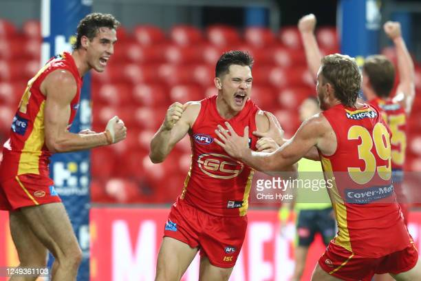 Ben Ainswort of the Suns celebrates a goal during the round 2 AFL match between the Gold Coast Suns and the West Coast Eagles at Metricon Stadium on...