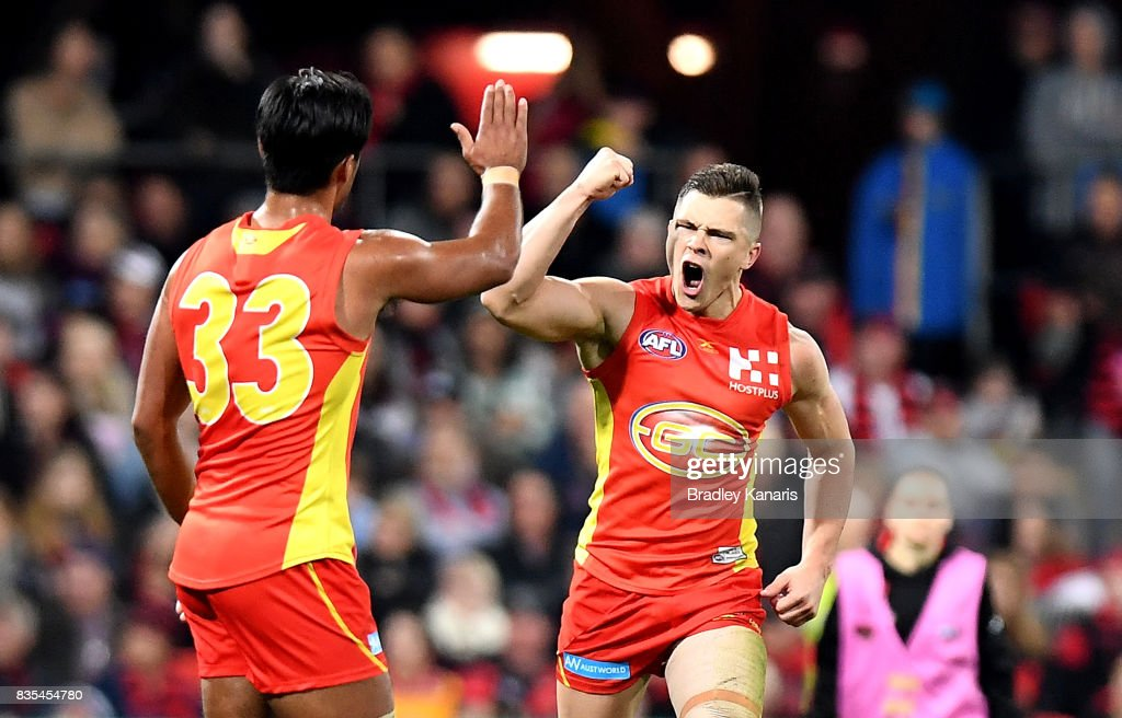 Ben Ainsworth of the Suns celebrates after kicking a goal during the round 22 AFL match between the Gold Coast Suns and the Essendon Bombers at Metricon Stadium on August 19, 2017 in Gold Coast, Australia.