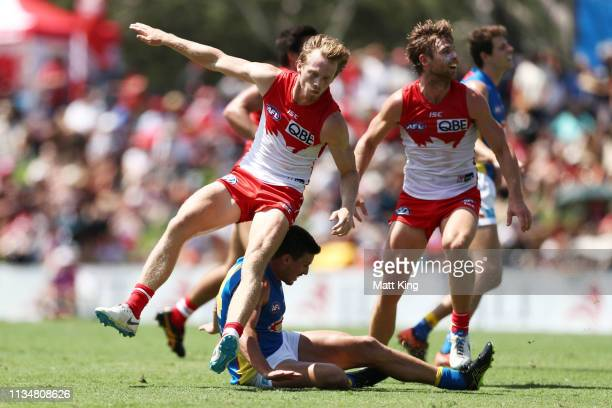 Ben Ainsworth of the Suns collides with Callum Mills of the Swans after kicking a goal during the 2019 JLT Community Series AFL match between the...