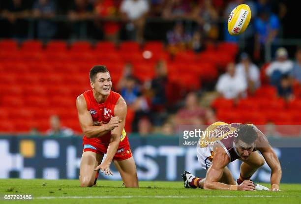 Ben Ainsworth of the suns in action during the round one AFL match between the Gold Coast Suns and the Brisbane Lions at Metricon Stadium on March...