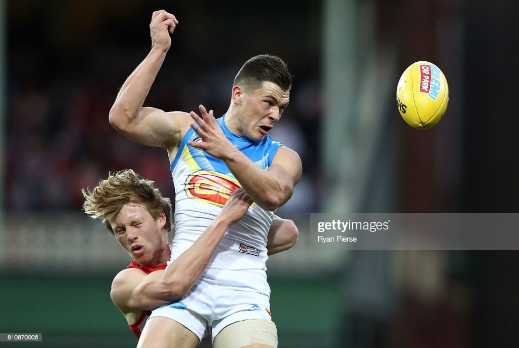 Ben Ainsworth of the Suns is tackled by Callum Mills of the Swans during the round 16 AFL match between the Sydney Swans and the Gold Coast Suns at Sydney Cricket Ground on July 8, 2017 in Sydney, Australia.