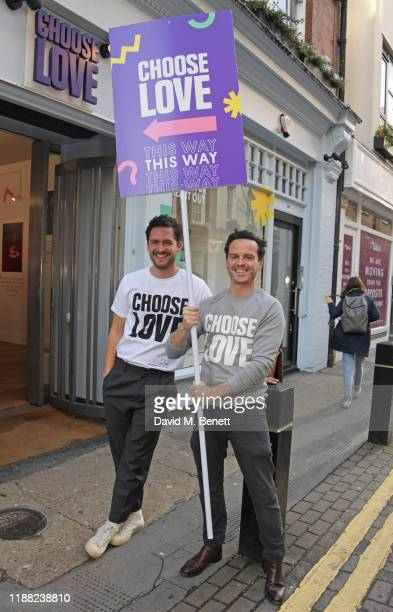 Ben Aldridge and Andrew Scott volunteer during Match Fund day at the 'Choose Love' shop for Help Refugees in Covent Garden on December 13 2019 in...
