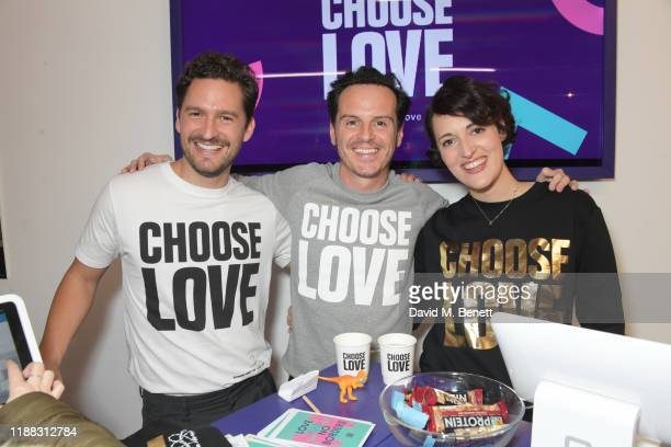 Ben Aldridge Andrew Scott and Phoebe WallerBridge volunteer during Match Fund day at the 'Choose Love' shop for Help Refugees in Covent Garden on...