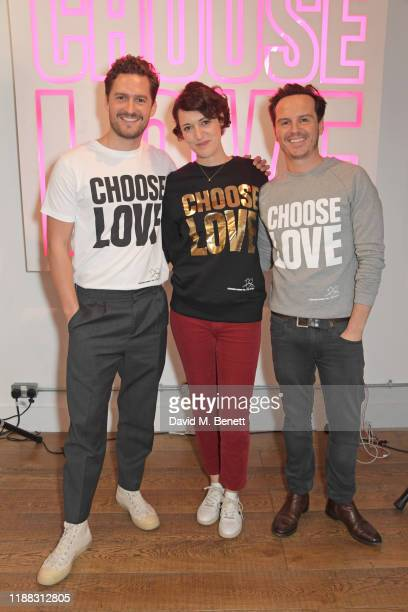 Ben Aldridge Phoebe WallerBridge and Andrew Scott volunteer during Match Fund day at the 'Choose Love' shop for Help Refugees in Covent Garden on...