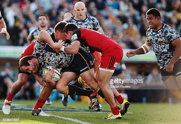 Ben Alexander of the Brumbies is tackled during the round nine Super Rugby match between the Brumbies and the Crusaders at GIO Stadium on April 24...