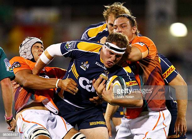 Ben Alexander of the Brumbies takes on the Cheetahs defence during the round nine Super 14 match between the Brumbies and the Cheetahs at Canberra...