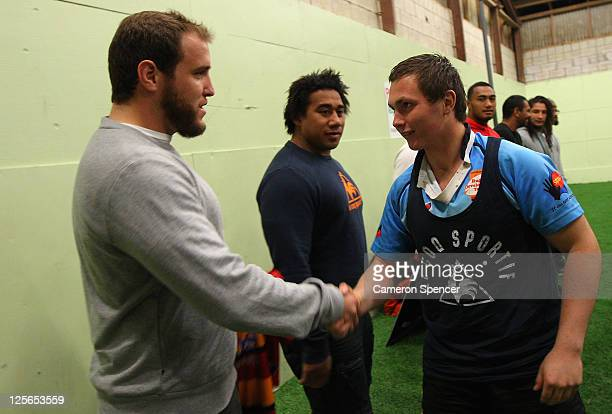 Ben Alexander of the Wallabies presents a jersey to a member of the U16's All Indigenous rugby team during an Australian Wallabies IRB Rugby World...