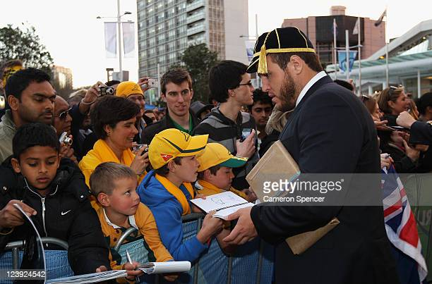 Ben Alexander of the Wallabies signs autographs during the Australian Wallabies IRB Rugby World Cup 2011 official team welcome ceremony at Aotea...